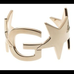Authentic Givenchy gold star cuff bracelet